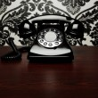 Vintage telephone at the desk — Stock Photo