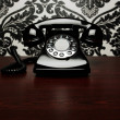 Vintage telephone at the desk - Foto Stock