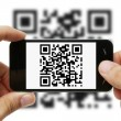 Scanning QR code with mobile phone - Foto Stock