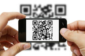Scanning QR code with mobile phone — Стоковое фото