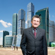 Businessman and office buildings - Stock Photo