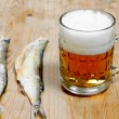 Dead dry salty fish and beer — Stock Photo