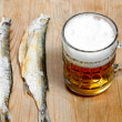 Dead dry salty fish and beer — Stock Photo #8938116