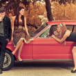 60s or 50s style image young with car — Foto Stock