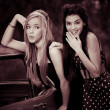 60s or sixties girls with car - Stock Photo