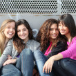 Mixed race group of smiling girls - Stok fotoğraf