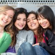 Mixed race group of smiling girls - Stock Photo