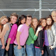 Group of diverse students or teens on campus - Stock Photo