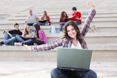 Students on campus working outdoors — Stock Photo