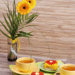 Tea with cake and gerberas flowers — Stock Photo