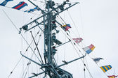 Mast of the military ship and alarm flags — Stockfoto