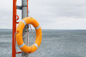 Lifebuoy ring on a background of the sea — Photo