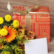 Royalty-Free Stock Photo: Giftbox and a bouquet of flowers