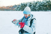 The woman pours from a thermos tea, in winter on walk — Stock Photo