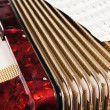 Red accordion and sheet music, close up — Stock Photo
