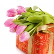 Stock Photo: Pink tulips and gift box, it is isolated on white