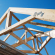 Stock Photo: Wooden rafters against blue sky