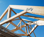 Wooden rafters against the blue sky — Stock Photo