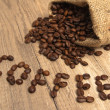 Grains of coffee on a wooden surface - Foto de Stock