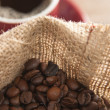 Cup of coffee with beans — 图库照片