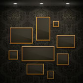 Golden frames on the wall. — Stock Vector
