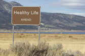 Road Sign - Ahead Series - healthy life — Stock Photo