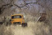 Old abandoned orange truck — Stock Photo