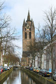 Canal and church tower in Delft, Netherlands — Stock Photo