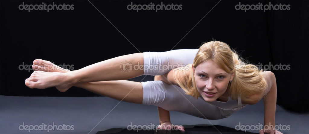 Young beautiful girl is professionally engaged in yoga — Stock Photo #8504646