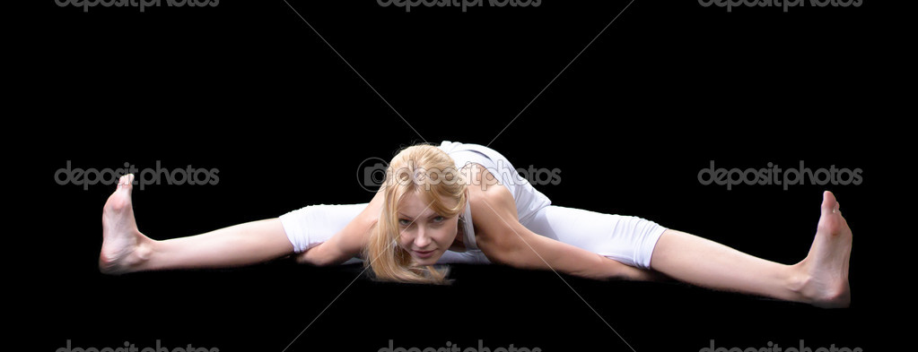 Young beautiful girl is professionally engaged in yoga — Stock Photo #8504664