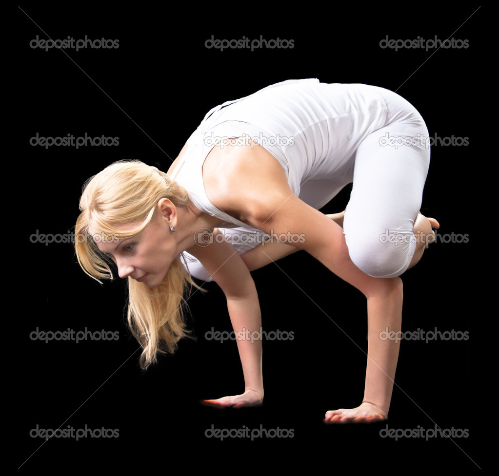Young beautiful girl is professionally engaged in yoga — Stock Photo #8504671