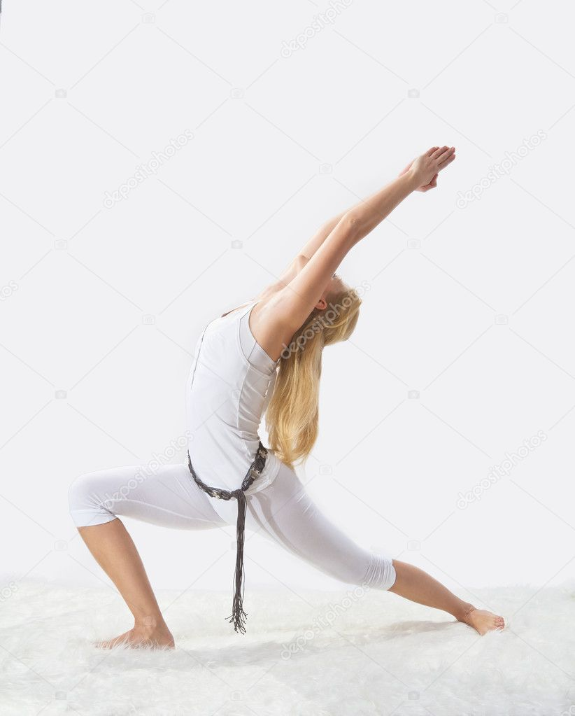 Young beautiful girl is professionally engaged in yoga — Stock Photo #8504678