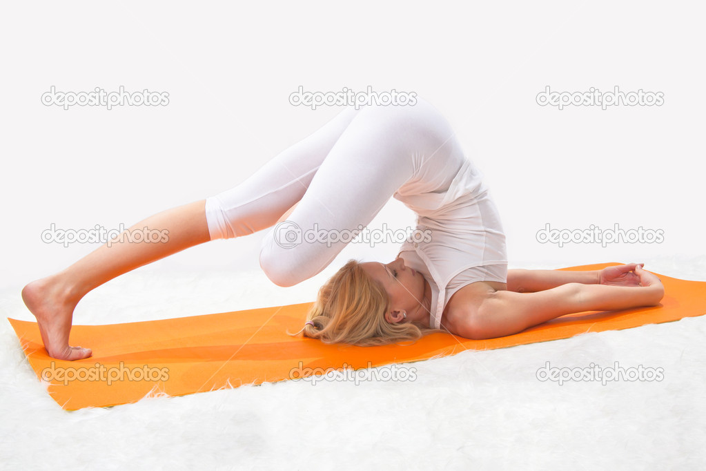 Young beautiful girl is professionally engaged in yoga — Stock Photo #8504701