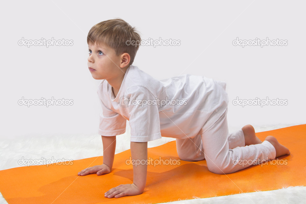 Baby  yoga. The little boy does exercise. — Stock Photo #8504705