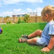 The kid with the ball on the grass — Stock Photo