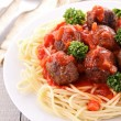 Spaghetti and tomato sauce with meatballs - Stock Photo