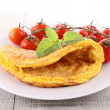 Omelette and cherry tomato — Stock Photo