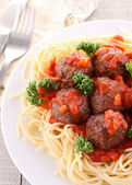 Spaghetti and tomato sauce with meatballs — Stock Photo