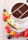 Chocolate fondue with fruits — Stock Photo
