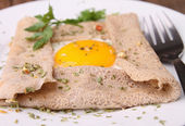 Buckwheat crepe and egg — Stock Photo
