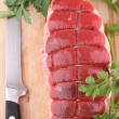 Isolated raw meat beef and parsley — Stock Photo #8369499