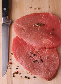 Raw meat and pepper — Stock Photo