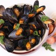 Stock Photo: Mussels and parsley on white