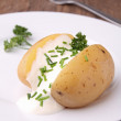 Stock Photo: Baked potato with cream