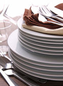Plates pile and cutlery — Stock Photo