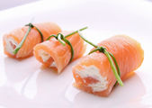 Appetizer, salmon roll with cheese — Stock Photo