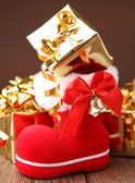 Christmas boot and gift — Foto de Stock