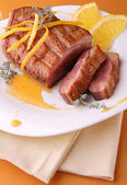 Plate of duck breast and orange sauce — Stock Photo