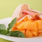 Melon and ham — Stock Photo
