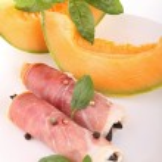 Melon and ham roll — Stock Photo
